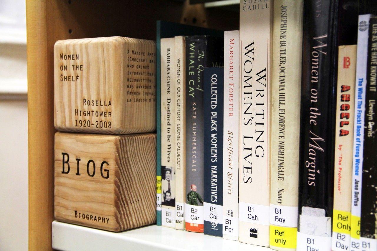 Books by women on a shelf